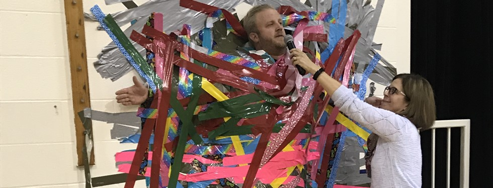 Mr. Barwell taped to the wall